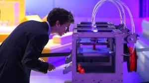 A 3D printer constructing a model of a human figure as a technician observers. Getty images.